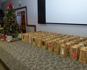 Each paper bag filled with cookies was decorated by children at the Child Development Center. (U.S. Air Force photo by Rebecca Amber)