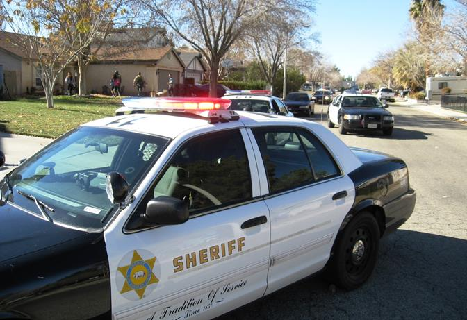 Deputies contained the neighborhood  near 15th Street East and Avenue K in Lancaster Monday as they pursued a burglary suspect. (Photo courtesy LASD)