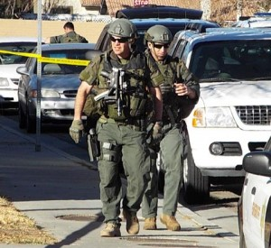The Special Weapons Team entered the home in the afternoon and found the suspect dead, officials said. (LUIS MEZA)