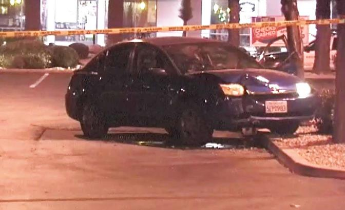 After the shooting, the victim's car came to rest in the Albertsons Shopping Center. (Photo by ED FROMMER)