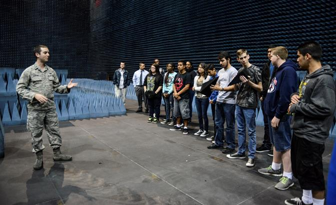1st Lt. Seth Martin, a 412th Electronic Warfare Group engineer, shows the students from local high schools what radio absorbent material looks like in the Benefield Anechoic Facility. (U.S. Air Force photo by Rebecca Amber)