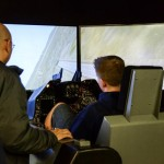 A student experiences the F-16 Simulator at the 412th Electronic Warfare group. (Rebecca Amber)