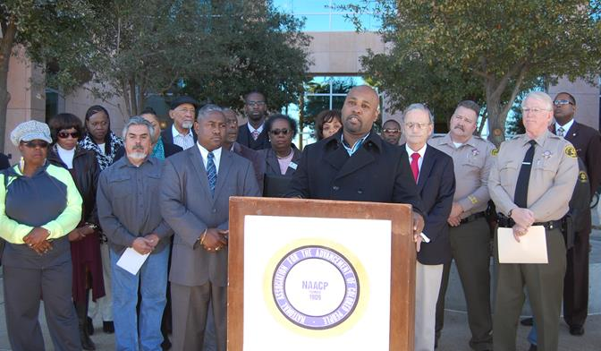 Nigel Holly of The Community Action League speaks at a press conference in front of the Antelope Valley courthouse Monday morning. Community leaders united at the press conference to address the hate fliers found recently in Lancaster and Palmdale.