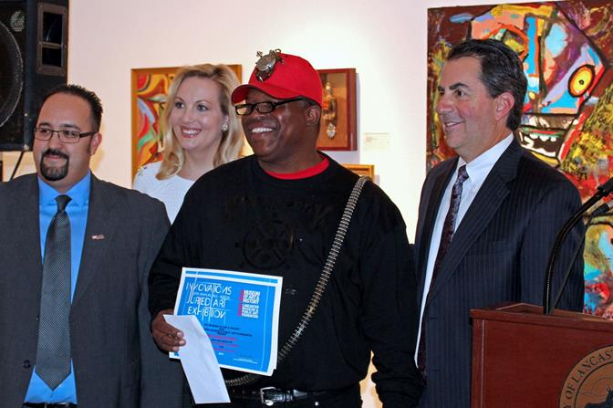 "Michael Evan (center) won the City Manager's Award to for his ""Steampunk Top Hat"" piece."