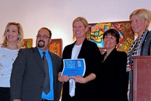 "Christine Kline (center) won Best of Exhibition for ""Origins."""
