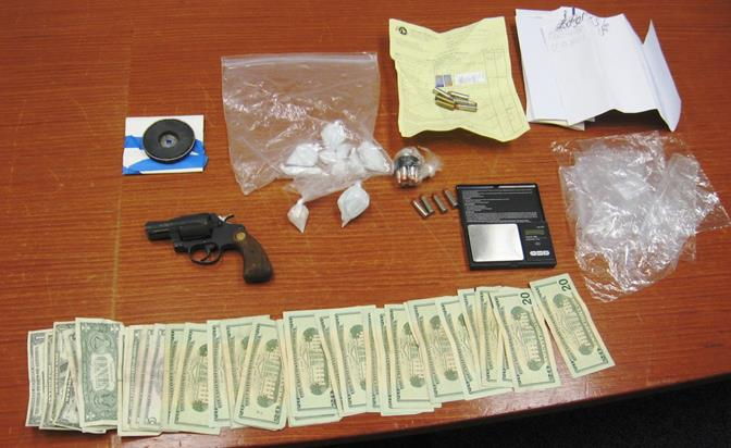 Approximately ¼ pound of methamphetamine, about $500 in cash, and handgun were seized when authorities served a search warrant at the couple's home. (Photo courtesy LASD)