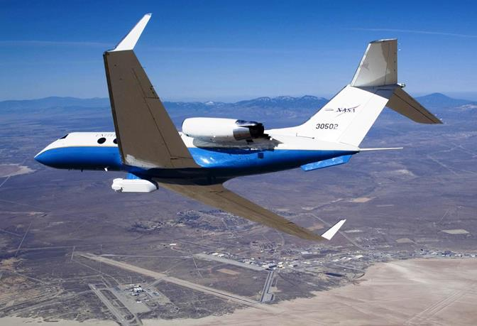 NASA's C-20A carrying the JPL-developed UAVSAR synthetic aperture radar banks over Edwards Air Force Base (NASA / Lori Losey)