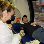 Jenny Zamora preps Aaron Price at a previous City of Palmdale blood drive.