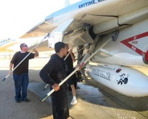 Volunteers clean planes at Joe Davies airpark.