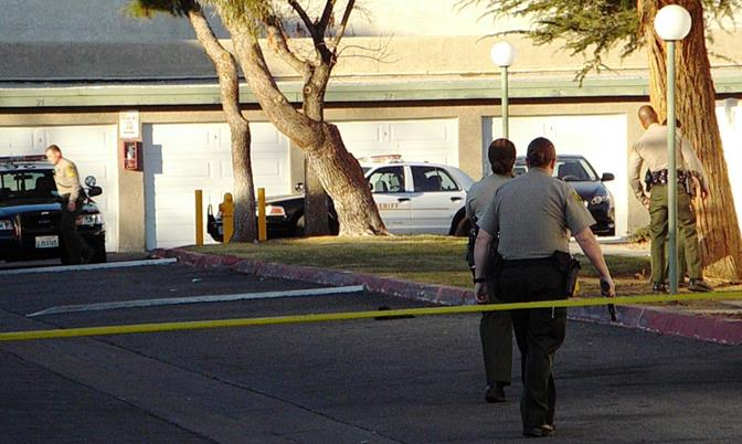Saturday afternoon, deputies with guns drawn surrounded the La Quinta Apartments in the 38000 block of 11th Street East in Palmdale. (Photo by JOHN MEZA)