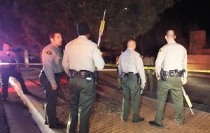 More than two dozen deputies responded to quell an agitated crowd that gathered at the scene and demanded answers from investigators. (LUIS MEZA)
