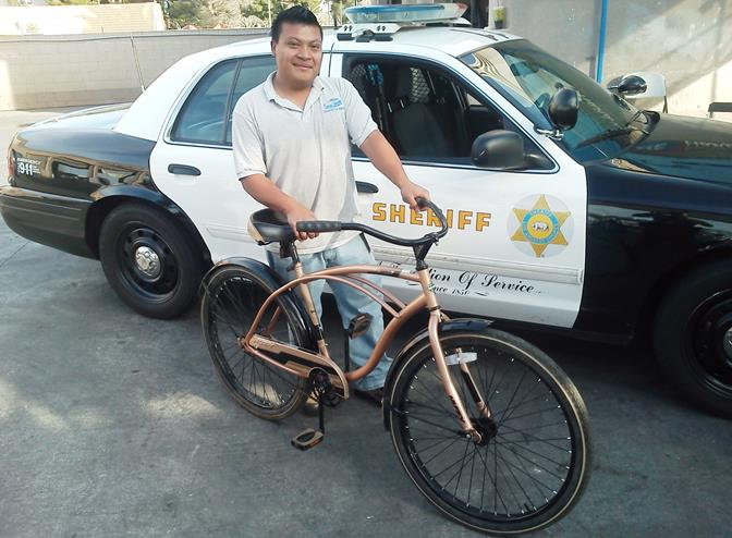 Rauda, 26, gratefully received the donated bicycle Saturday morning. (Photo courtesy LASD)