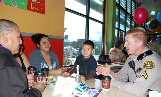 A local family speaks to Deputy Gilbert at the first Coffee with a Cop event in Palmdale on Feb. 7, 2014.