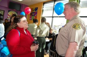 Captain Don Ford shares a laugh with a resident at Coffee with a Cop.