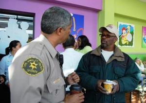 Palmdale business owner Rodney Ivey (right) said he came out to meet and greet the deputies.