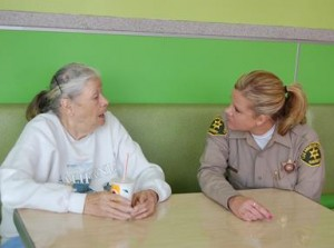 Deputy Jodi Wolfe sits for a chat with a resident.