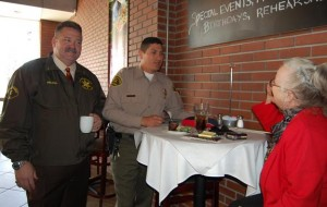 Captain Pat Nelson (left) and Deputy Ruiz shares a conversation with an attendee.