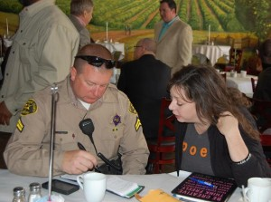 Deputy Addington speaks with a resident at a past 'Coffee with a Deputy' event. [file]