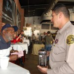 Deputy Miguel Ruiz speak with Lancaster resident Willie Green at the Feb. 13 'Coffee with a Deputy' meeting.