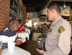 Deputy Miguel Ruiz speaks with Lancaster resident Willie Green at the Feb. 13 'Coffee with a Deputy' meeting.