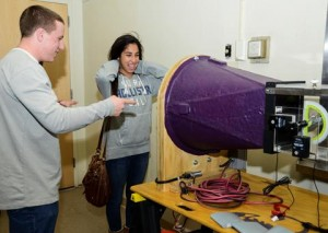 Charles Dobbin demonstrates his wind tunnel to another student at the Science Fair.