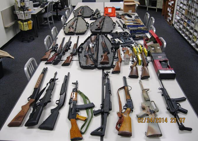 Thirty-one stolen firearms were recovered Monday night, when deputies raided a Lancaster home in the 43000 block of Halcom Avenue. (Photos courtesy LASD)