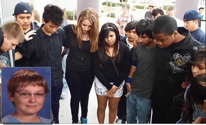 "Friends and loved ones formed a circle and sang ""Amazing Grace"" at a vigil at Eastside High School Saturday to remember Gage Rossi. (LUIS MEZA)"