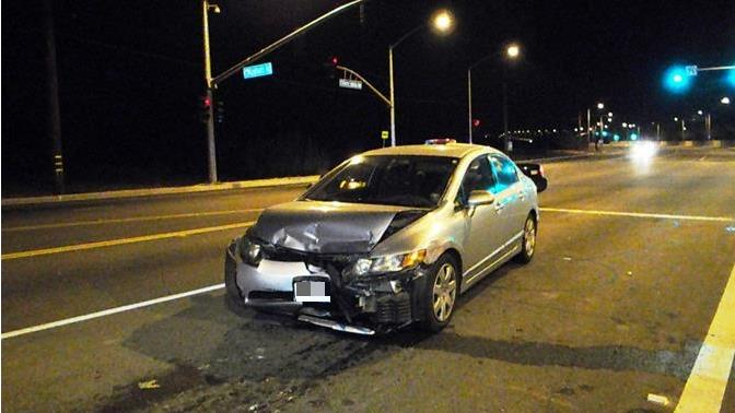 Hansen's 2007 Honda Civic cross the intersection of Tierra Subida Avenue and Rayburn Road into oncoming northbound traffic stopped at the red light, authorities said. (Photo by JOHN MEZA)