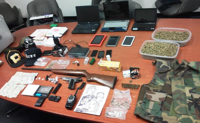 Authorities seized two firearms, ammunition, several possible stolen electronics, four pounds of marijuana, about 50 grams of heroin, and methamphetamine, officials said. (Photo courtesy LASD)