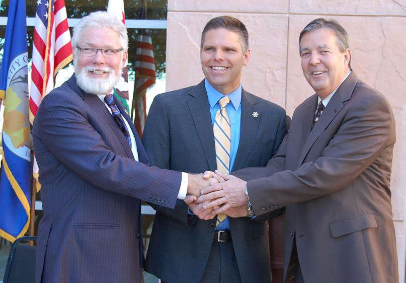 Parris and Ledford smiled and shook hands in front of the Antelope Valley Courthouse Tuesday morning, before announcing their support for James Hellmold (center) to be the next L.A. County Sheriff.