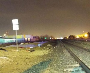The victim was pushing a cart full clothes across the tracks  when she was struck. (JOHN MEZA)