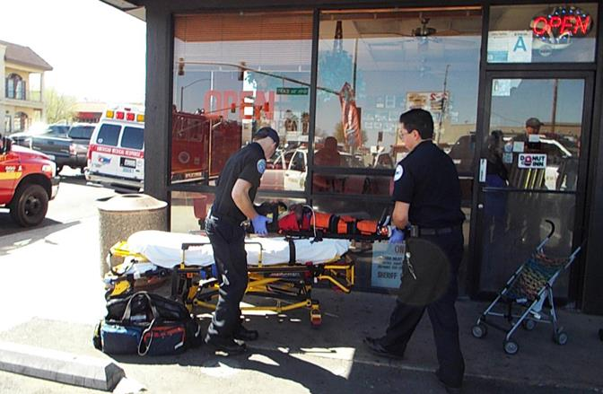 The toddler was airlifted to Children's Hospital as a precaution, after a passerby saw him being hit with a belt near 10th Street East and Palmdale Boulevard, authorities said. (Photo by LUIS MEZA)