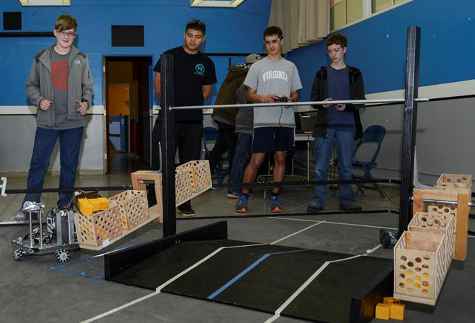 The Scorpion Robotics team, from Desert High School, prepares for the Los Angeles FIRST Tech Challenge Regional Championship Tournament at the end of February. (U.S. Air Force photo by Rebecca Amber)