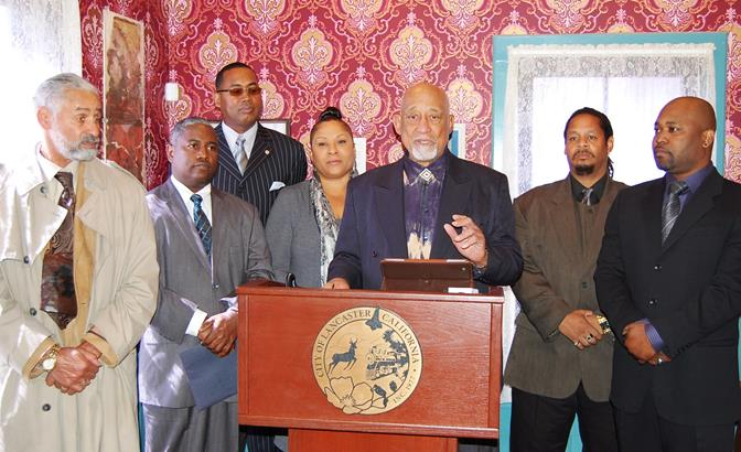 """Joining Hearns in announcing the new African American Leadership Council were (L to R) Emmett Murrell, Executive Director of Murrell's Farm and Boys Home; V. Jessie Smith, President of the NAACP-Antelope Valley Chapter; Ansar """"Stan"""" Muhammad, founder of the H.E.L.P.E.R. Foundation; Gwen Cole of the High Desert Alliance of Black School Educators; Pharaoh Mitchell, co-founder of The Community Action League; and Nigel Holly co-founder of The Community Action League."""
