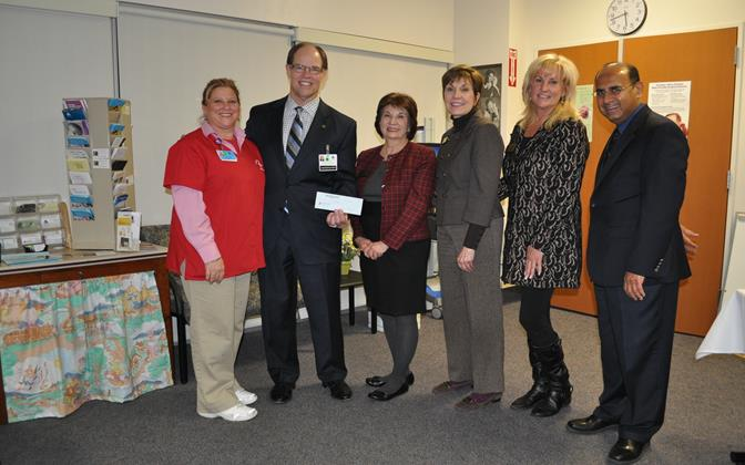 Alpha Charter Guild members join AV Hospital Administrators at the check presentation.  (L to R) Wynne May, Dennis Knox, Fran Marroquin, Phyliss Reily, Beverly Horwedel and  Antelope Valley Healthcare District Board Member, Doddanna Krishna, M.D.