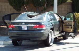 At least four bullet holes could be seen in the back windshield of the BMW. (LUIS MEZA)