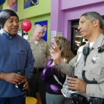 Palmdale Sheriff's Station deputy Ray Wilson speaks with a local business owner at the Palmdale Stations first 'Coffee with a Cop' event Feb. 7.