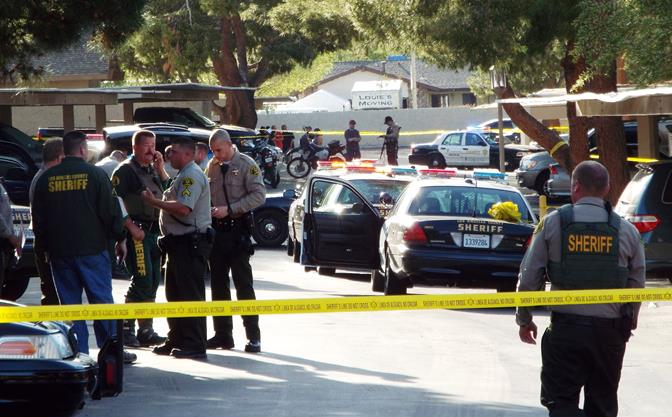 Several officers responded to the Sunset Ridge Apartments Sunday afternoon, following a deputy-involved shooting that wounded a domestic dispute suspect. The man was treated for non-life-threatening injuries, and the  fire arm he used was recovered at the scene, officials claim. (Photo by JOHN MEZA)