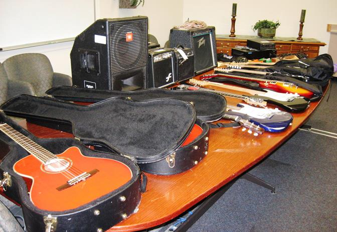 Detectives recovered eight guitars, five amplifiers, and some school clothing at three Lancaster homes. Still outstanding are multiple Eastside High School clothing items with black and purple colors, one desktop computer, one laptop computer, 12 electric and acoustic guitars, and a sound mixer.  (Photo courtesy LASD)