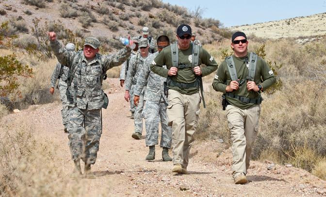 A couple deputies from the U.S. Marshals Service  joined a group of about 30 on March 4 for the 412th Security Forces Squadron Ruck March. (U.S. Air Force photo by Jet Fabara)