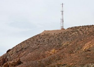The 11.5-mile ruck march ended atop the mountain with the communications tower near the edge of Rosamond, perpendicular to the west Edwards AFB sign. (Jet Fabara)