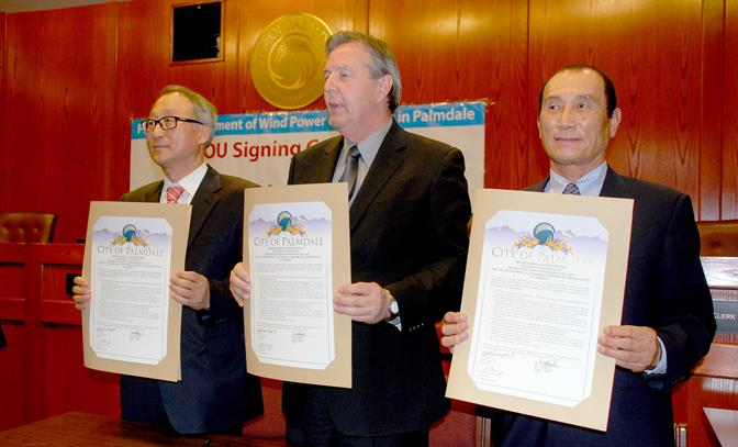 (L to R) Pishon Energy Chairman Dr. Byoung-Doo Lee, Palmdale Mayor Jim Ledford and Anywind Chairman Manho Joung show the MOU to build wind turbine systems in Palmdale.