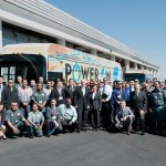 California Governor Jerry Brown stands with the Lancaster employees of BYD Motors on Monday at the unveiling ceremony of the first American-made, long-range, electric bus. (Photo courtesy BYD)