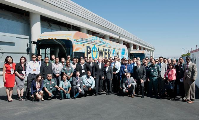 California Governor Jerry Brown stands with the Lancaster employees of BYD Motors on Monday, April 28, at the unveiling ceremony of the first American-made, long-range, electric bus. (Photo courtesy BYD)
