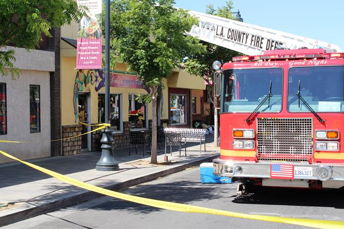 Daisy's Costumes, located on the 600 Block of Lancaster Boulevard, was damaged by a fire, first reported around 6:20 a.m. Thursday, April 24. (Photo by TONY CHEVAL)
