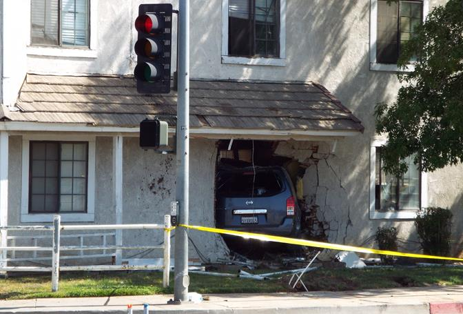 The crash happened early Sunday morning at an apartment building in the 1000 block of East Avenue R in Palmdale.  Sunday afternoon, the SUV was still embedded. (Photo by LUIS MEZA)