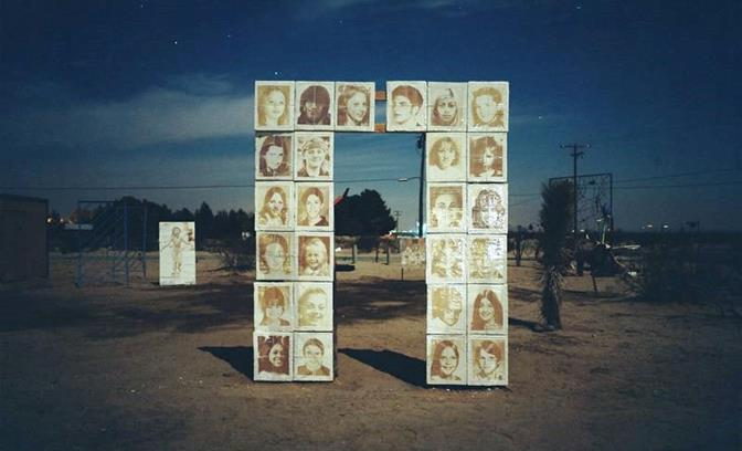 """""""The Portal"""" is an outdoor collection of eclectic sculptures located off the 14 Freeway, just before Lutie Avenue on California City Boulevard. The sculpture, by German artist Dennis Rudolph, features images of missing children from California that are rendered in a clay doorway, presented as a monument to their stories so they will not be forgotten. (Courtesy Dennis Rudolph, The Portal, Mixed Media, 2014)"""