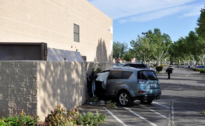 High winds forced this SUV off the road and into a side wall at the Cinemark 12 Movie Theater on Valley Central Way and Lancaster Boulevard, its driver claims. The driver suffered minor injuries and was cited for being an unlicensed driver, and no other injuries were reported.