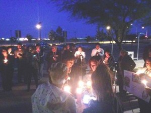 Nearly 60 residents and community leaders participate in Wednesday's Prayer & Candlelight Vigil at the Antelope Valley Courthouse.