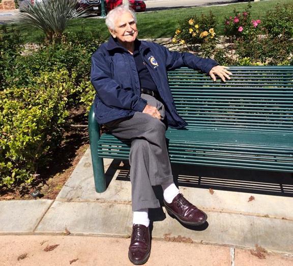 Larry Chimbole seated on bench 2